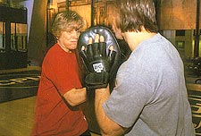 Psychologist Ellen McGrath spars with trainer Mark Tenore
